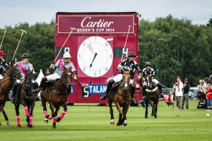 An image of polo players playing in a Cartier Queen's Cup match - book a chauffeur to this event from GandT Executive