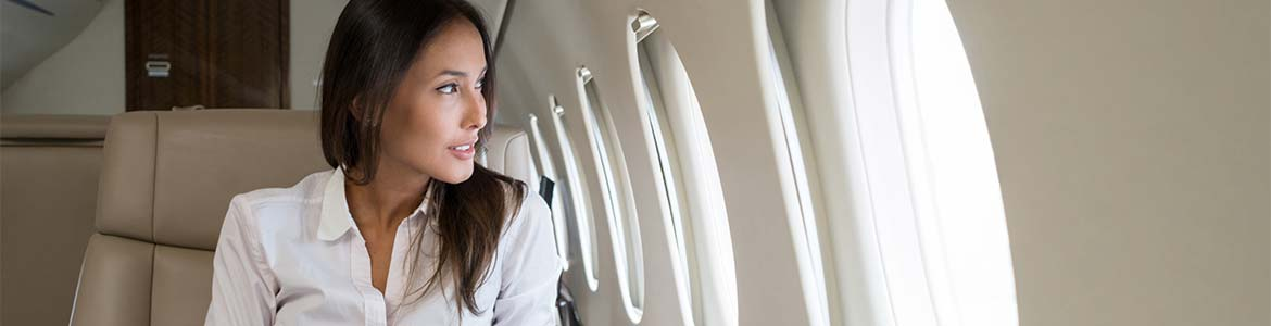 An image of a woman sitting in a plane after completing a Newbury airport transfer provided by GandT Executive.