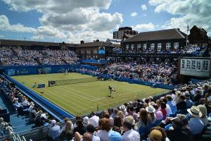 An image of tennis players competing in the Aegon Championchips tennis championchips at Queens Club - book a chauffeur to this event from GandT Executive