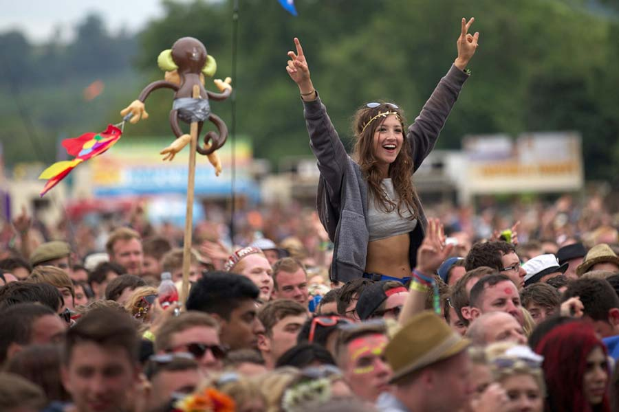 An image of crowds at the Glastonbury Festival - book a chauffeur to this event from GandT Executive