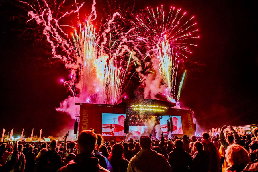 An image of a band playing at Reading Music Festival - book a chauffeur to this event from GandT Executive