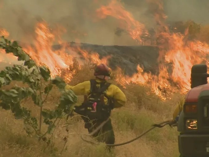Firefighters continue to battle raging wildfires in