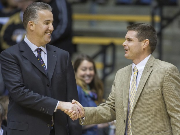 Purdue coach Matt Painter shakes hands with Purdue alum and Carroll head coach Carson Cunningham before their game Purdue Friday, November 7, 2014, at Mackey Arena in West Lafayette.