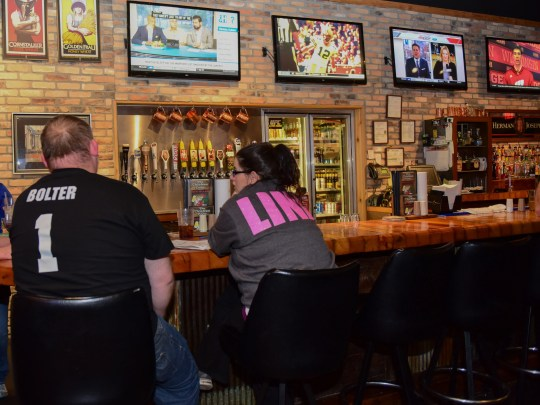 Customers relax at the bar and enjoy the games at Chicken