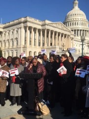 Melanie Campbell, president of the National Coalition on Black Civil Participation, and other women attending the Black Women's Roundtable conference March 14, 2018, talk to reporters outside the U.S. Capitol.