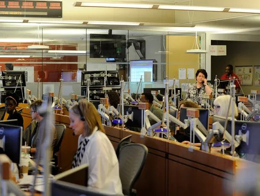CDC workers analyze Ebola details in the CDC's Emergency