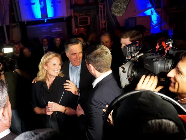 Mitt Romney greets supporters with his mother Ann at