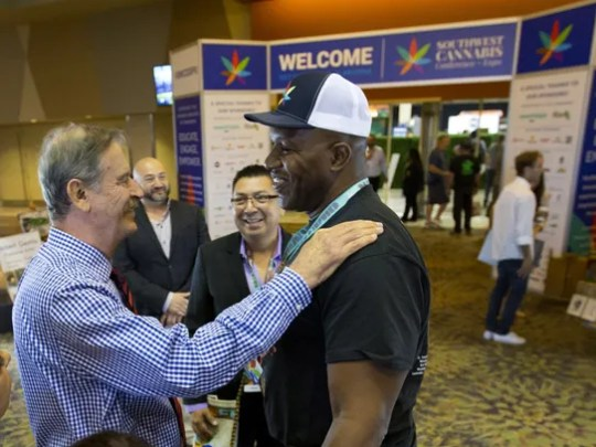 Former Mexican President Vicente Fox (left) is greeted