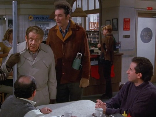 Frank Costanza (Jerry Stiller), with the Festivus pole, tries to get his son George (Jason Alexander) into the holiday spirit.