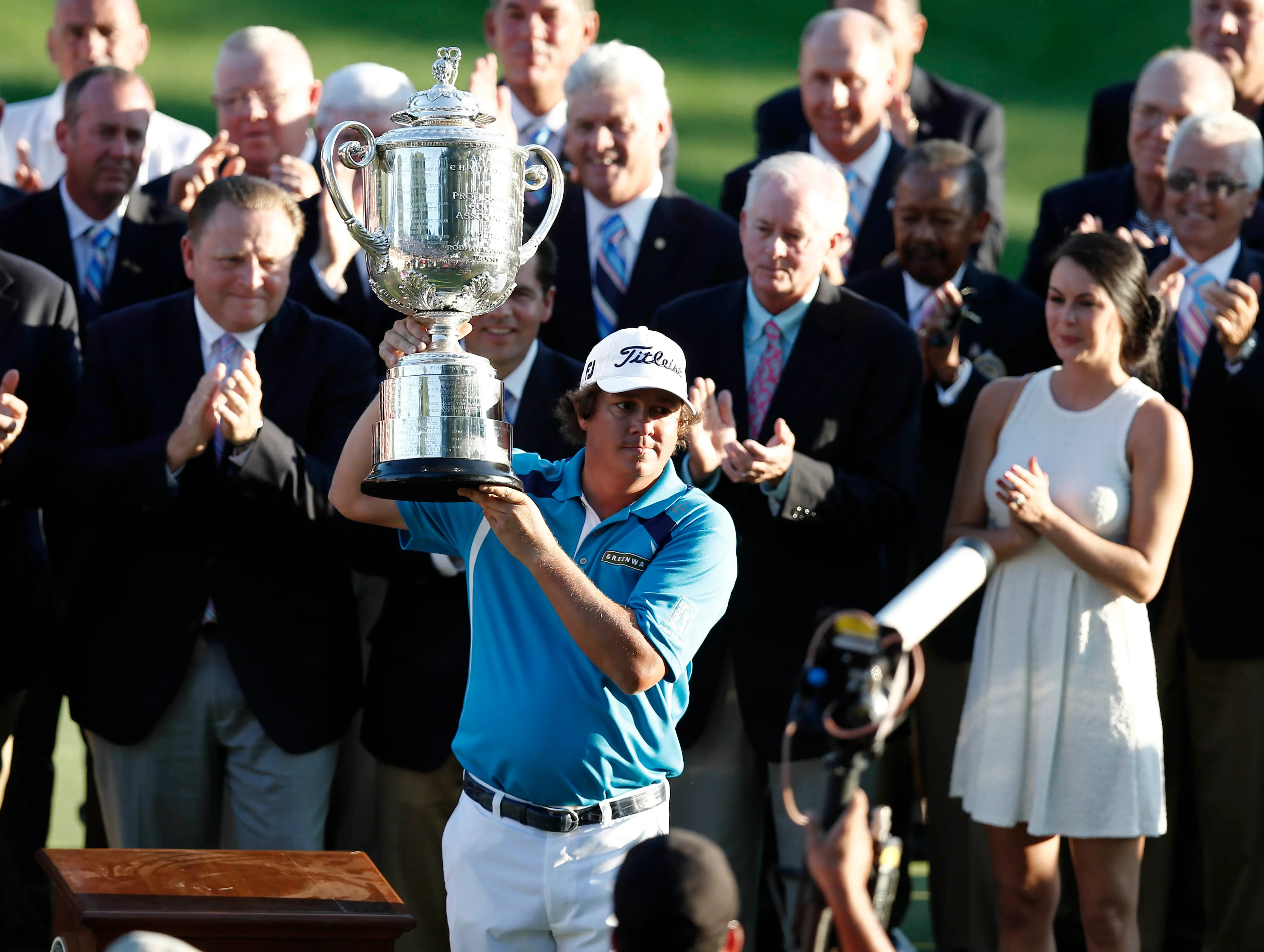 Jason Dufner hoists the Wannamaker Trophy after winning the 95th PGA Championship on Sunday at Oak Hill Country Club in Rochester, N.Y.