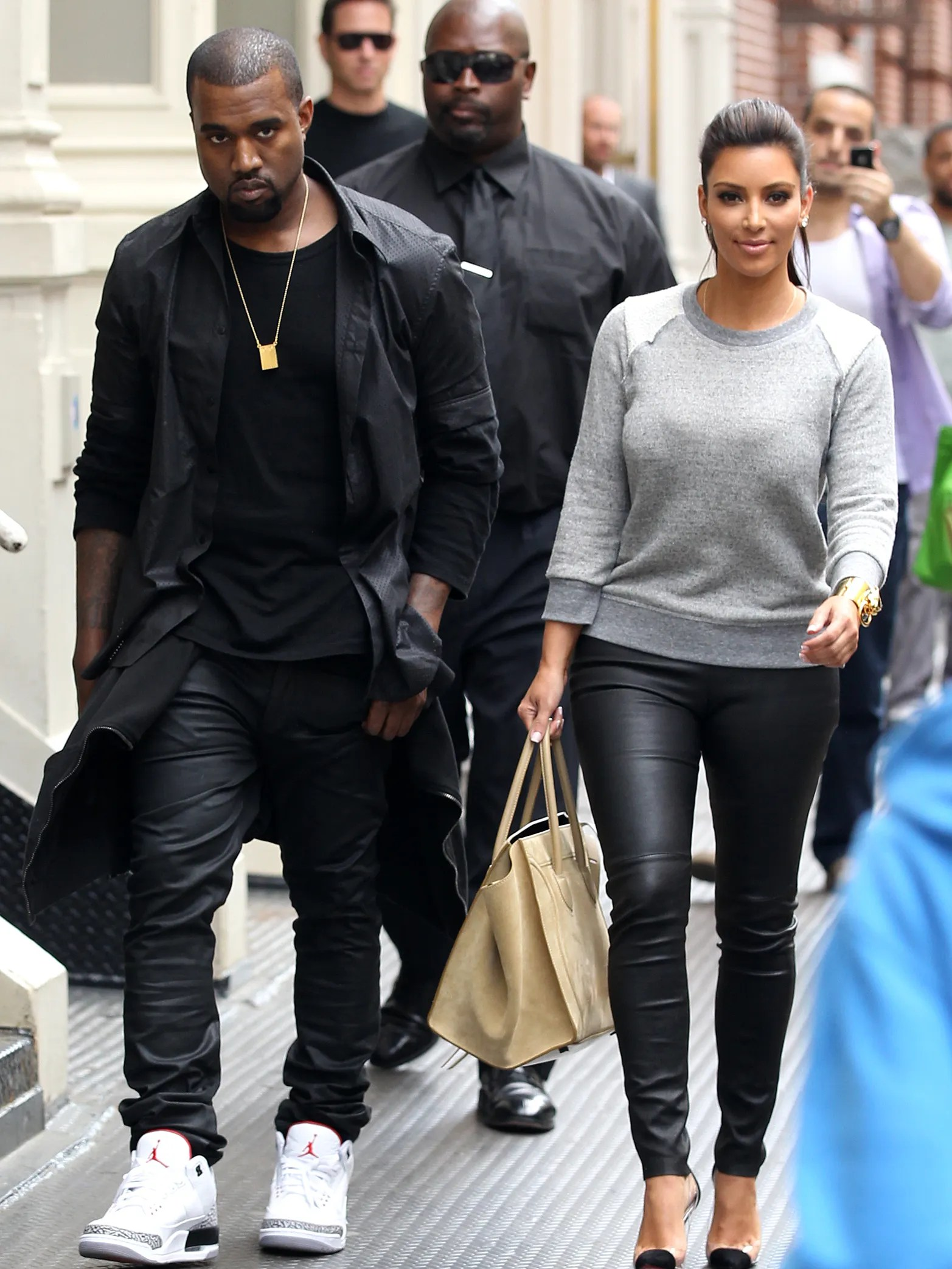 A perpetually annoyed-looking West walks with Kardashian in New York City in April 2012. Why so mad, Yeezus?
