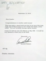 Personal letters written by Arnold Palmer are displayed