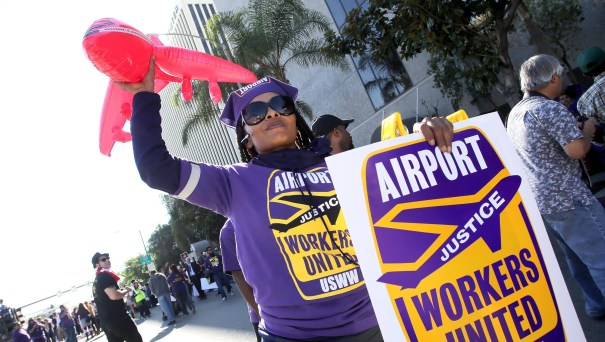 A woman joins hundreds of low-wage and minimum-wage workers and activists demonstrating outside the Los Angeles International Airport on Nov. 29, 2016, to increase the nationwide minimum wage to $15 an hour.