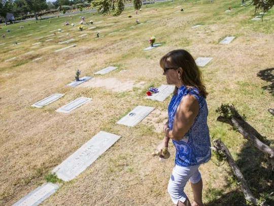 Sharon Johnston sometimes finds the grave markers of