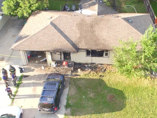 636416129042165212-PFA-drone-image-front-of-home.jpg
