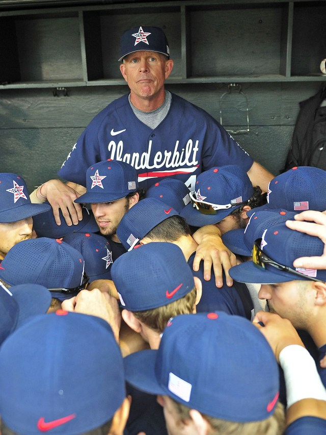 Vanderbilt coach Tim Corbin talks with his players in the dugout after the Commodores defeated Radford 21-0 in the NCAA Regionals on June 1, 2015.