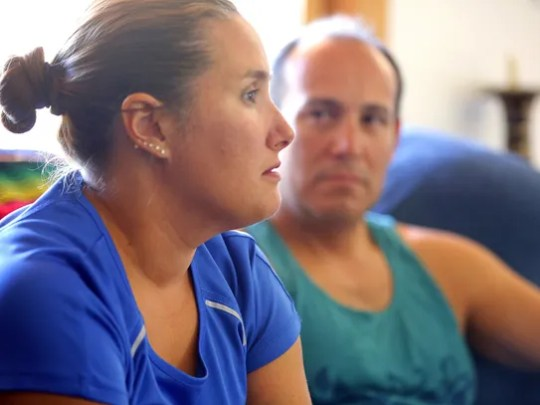 Sergio Celis (right) watches as his wife, Becky, discusses