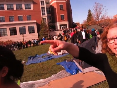 A video showing a photographer's clash with University of Missouri protesters who tried to block his access in a public section of campus is fanning debate about freedom of the press. (Nov. 10) AP