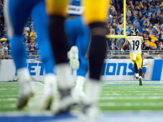 Steelers receiver JuJu Smith-Schuster (19) runs for a 97-yard touchdown during the third quarter against the Lions on Sunday.