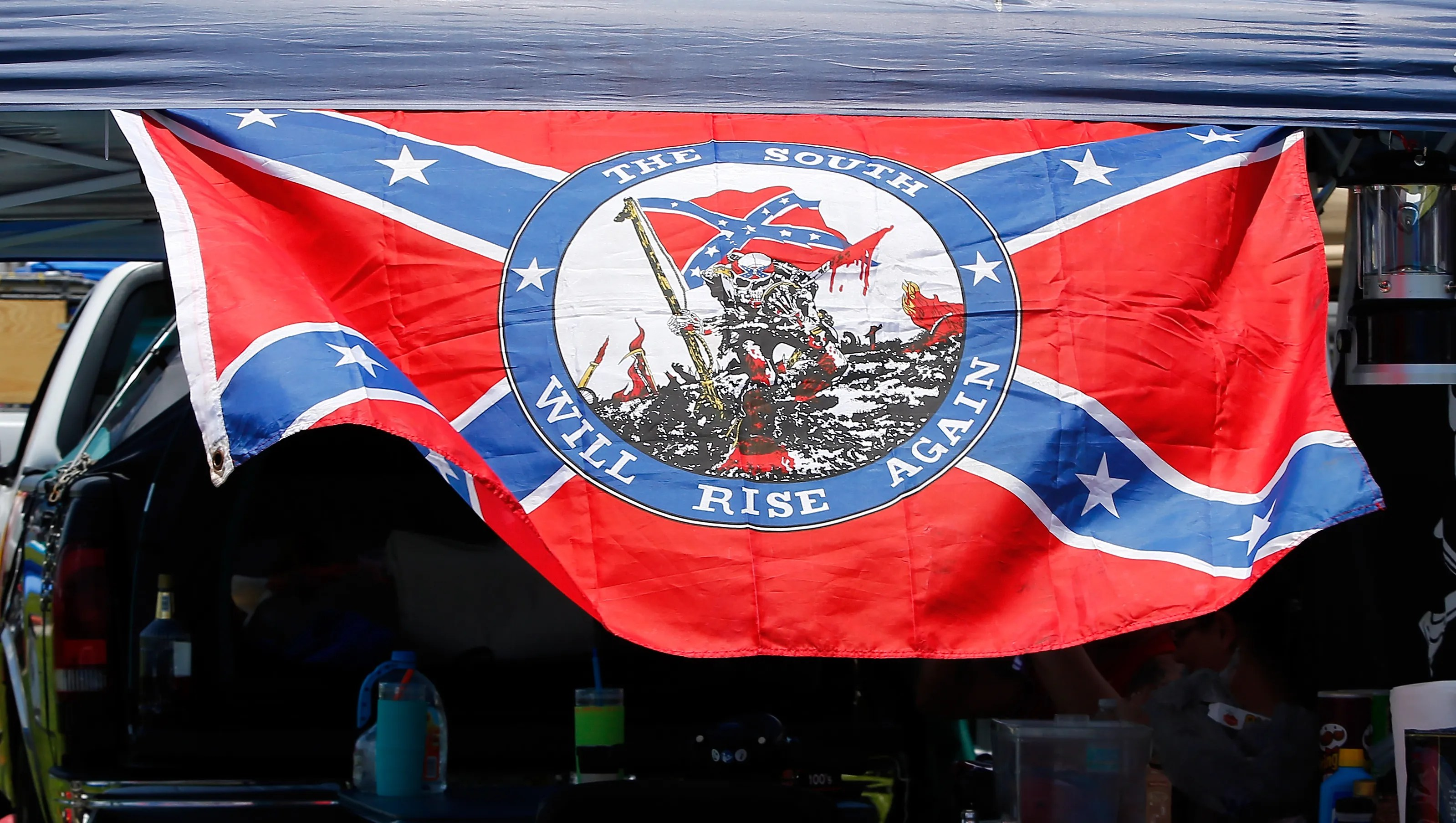 A Confederate flag is seen before practice at Daytona International Speedway on July 3, 2015. NASCAR chairman Brian France called it an ''offensive symbol'' that year and asked tracks to try to remove them.