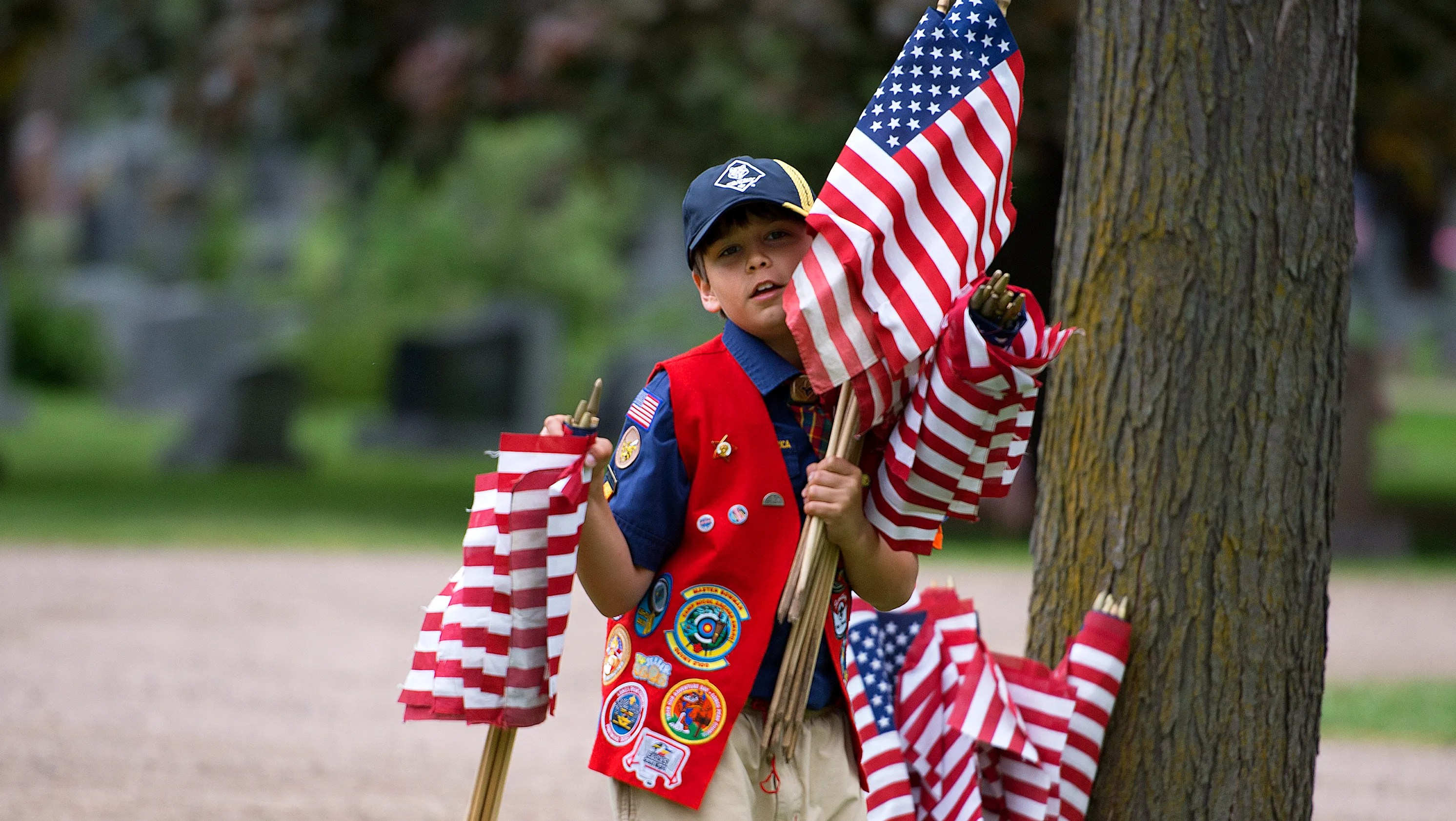 Boy Scouts Place American Flags On Graves In Honor Of