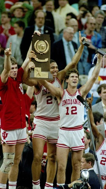 Indiana players Todd Meier, left, Daryl Thomas, center,