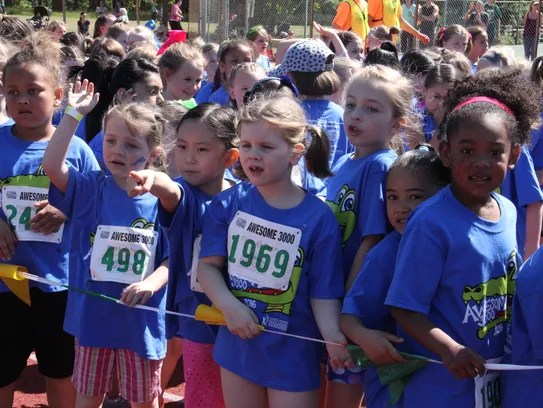First grade girls line up for the start of their run