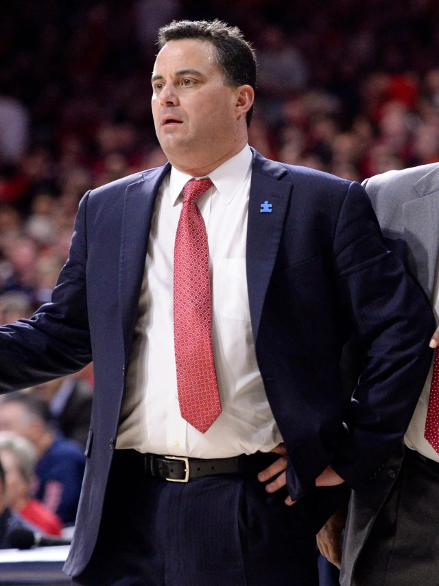 Feb 10, 2018; Tucson, AZ, USA; Arizona Wildcats head coach Sean Miller (left) and associate head coach Lorenzo Romar (middle) and assistant coach Mark Phelps (right) react to a call during the first half against the Southern California Trojans at McKale Center. Mandatory Credit: Casey Sapio-USA TODAY Sports