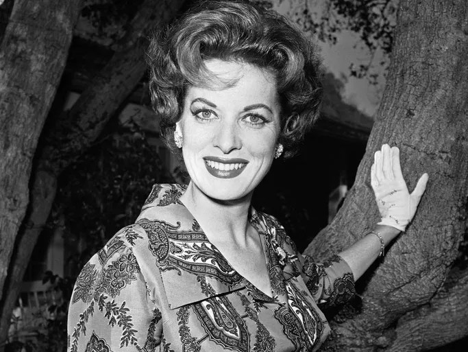 Actor Maureen O'Hara photographed in her front yard