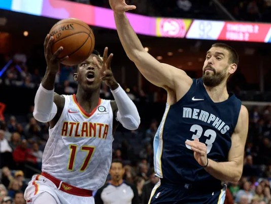 Atlanta Hawks guard Dennis Schroder (17) shoots against Memphis Grizzlies center Marc Gasol (33) in the second half of an NBA basketball game Friday, Dec. 15, 2017, in Memphis, Tenn. (AP Photo/Brandon Dill)