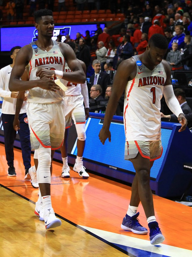 Mar 15, 2018; Boise, ID, USA; Arizona Wildcats guard Rawle Alkins (1) and forward Deandre Ayton (13) walk off the court after the game against the Buffalo Bulls during the first round of the 2018 NCAA Tournament at Taco Bell Arena. Mandatory Credit: Brian Losness-USA TODAY Sports