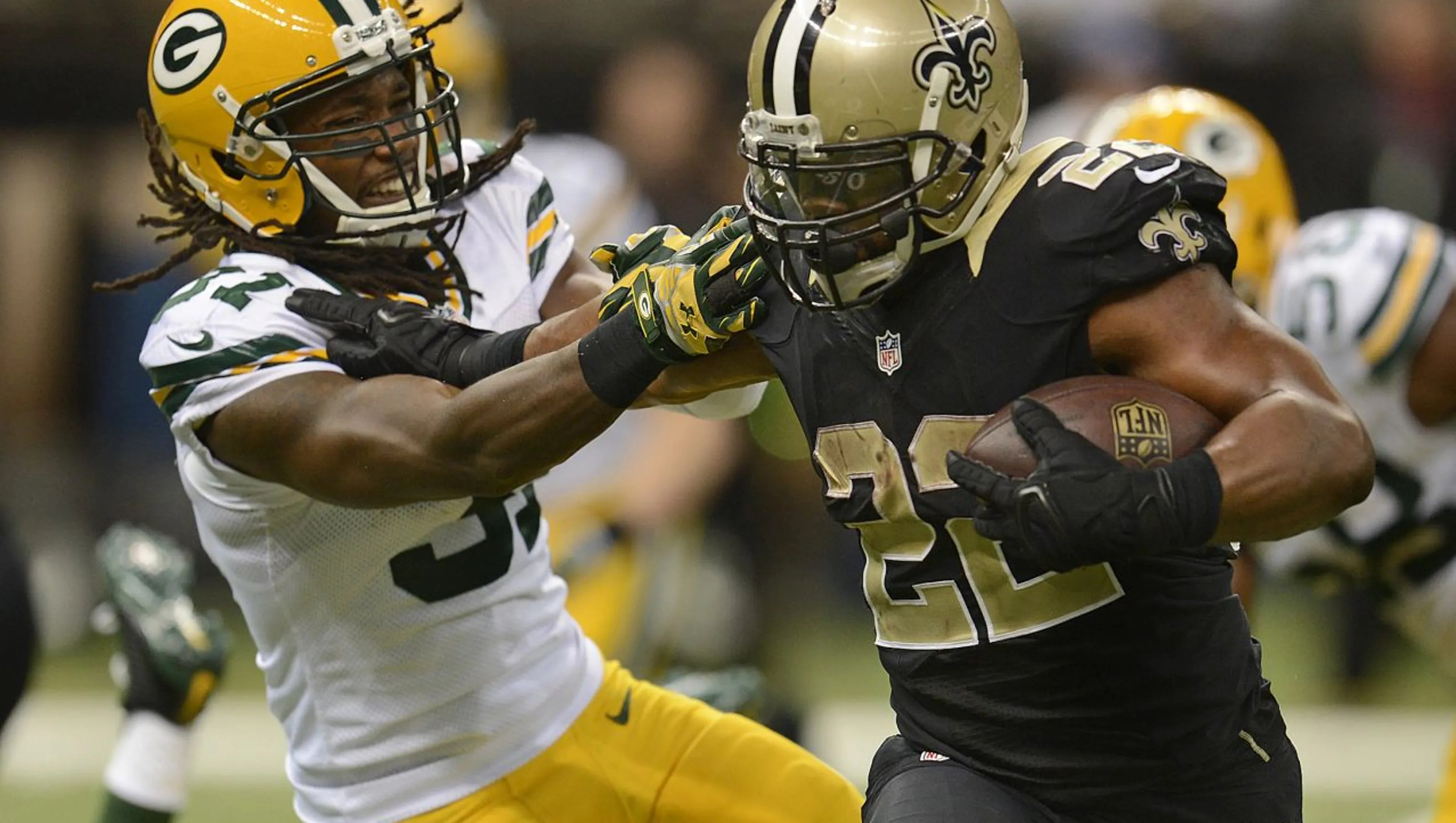 Mark Ingram of the New Orleans Saints and Devon House of the Green Bay Packers