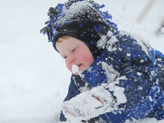 Bridger Wagner, 3, of Sioux Falls, plays in the snow