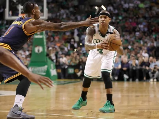 FILE - In this Friday, May 19, 2017 file photo, Boston Celtics guard Isaiah Thomas looks to pbad the ball as Cleveland Cavaliers guard Iman Shumpert, left, defends during the first half of Game 2 of the NBA basketball Eastern Conference finals in Boston. Day by day, Isaiah Thomas looks a little more like an All-Star point guard like himself. And just maybe like one who can rescue the reeling Cavaliers. Thomas has been increasing his workout load and is making strong progress in his recovery from a hip injury that ended his 2016 in Boston and delayed the start of his 2017 season with Cleveland, Tuesday, Nov. 7, 2017. (AP Photo/Elise Amendola, File)