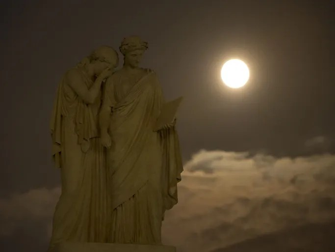 A perigree full moon or supermoon is seen over the Peace Monument on the grounds of the U.S. Capitol in Washington, D.C.