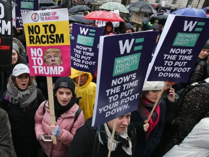 Protesters hold up placards during the Women's March