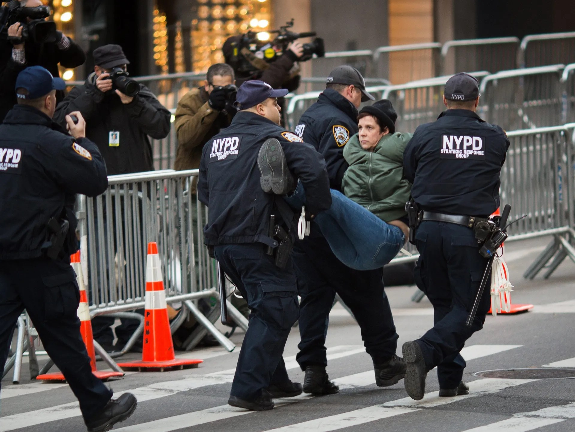 Officers carry away a protester who had breached the