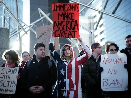 Americans and other expatriates gather to protest President