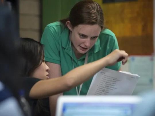 Chemistry teacher Lauren Cooney works with Michelle