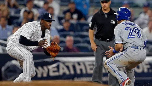 New York Yankees relief pitcher Luis Severino catches