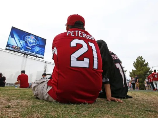 Arizona Cardinals fans watch the action at the draft