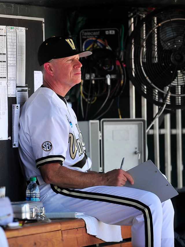 Vanderbilt Head Coach Tim Corbin watches the game against Texas in the dugout at the College World Series at TD Ameritrade Park in Omaha, Neb., Friday, June 20, 2014. Vanderbilt lost 4-0.