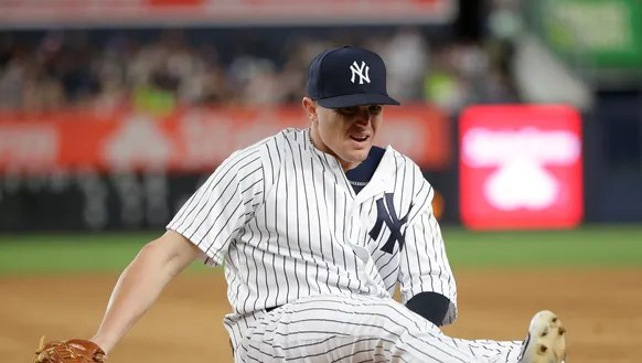 New York Yankees first baseman Chris Parmelee reacts