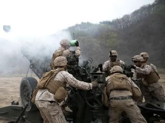 Artillery Marines fire off rounds from M777A2 lightweight