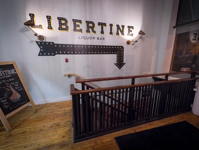 The entrance to the Libertine Liquor Bar can be found