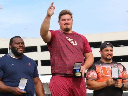 Austin Droogsma celebrates after winning the shot put at the ACC Outdoor Track & Field Championships.