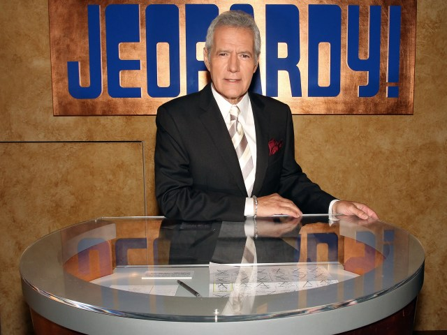 """Host Alex Trebek poses on the """"Jeopardy!"""" set in 2011."""