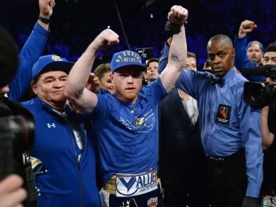 Canelo Alvarez, middle, celebrates beating Julio Cesar
