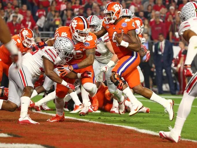 Clemson Tigers quarterback Deshaun Watson (4) scores