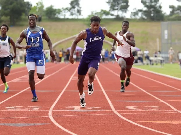 St. Aloysius' Demichael Harris crosses the finish line in first ...